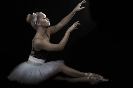 hairclip: Beautiful ballerina in seated ballet pose