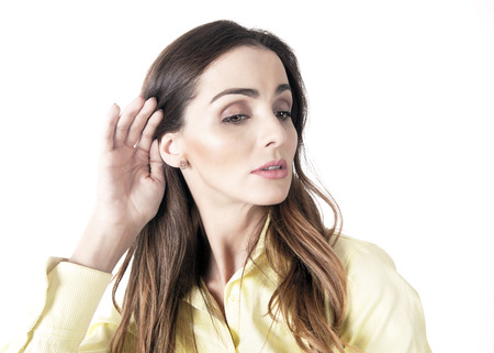furtive: Woman listening, cupping ear with serious expression
