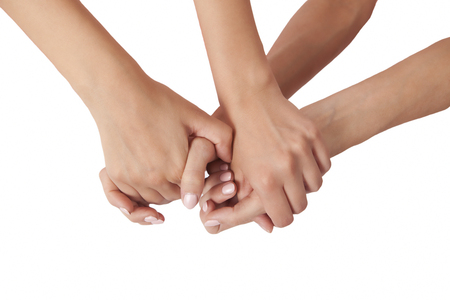 Two pairs of hands grasped together