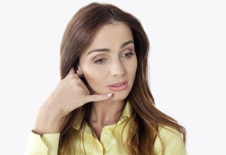 Pretty girl on hand telephone, making call me gesture Stock Photo