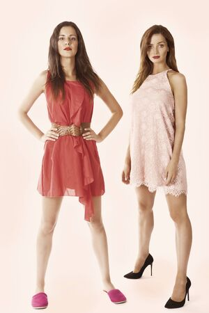 Two women in fashion clothes, standing portrait