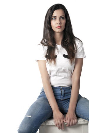 Young woman sitting and thinking, with copy space 스톡 콘텐츠