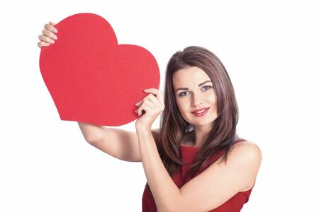 Cute woman with red heart placard for your message Zdjęcie Seryjne