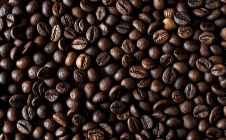 Roasted espresso coffee beans background.