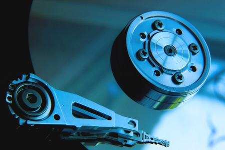 harddrive: Inside Hard Disk Drive HDD-Computer Hardware Components Focus on Head. Stock Photo