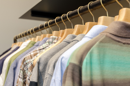 men's clothing: Various Mens Clothing On A Wooden Hanger. CloseUp shot with small GRIP.
