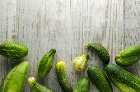 Healthy Food Background. Fresh Cucumbers On A Wooden White Table With Empty Space For Text. Top View .