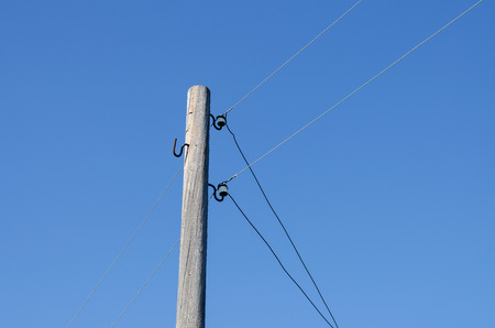 Wooden Poles (Support) Overhead Power Lines. Used As A Building For Holding Wires.