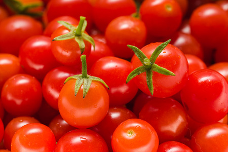 Lots of Small Ripe Red Cherry Tomatoes. Close Up. Macro. Top View. Background.