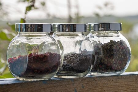 Spices In A Glass Jar. Paprika, Black Pepper, A Mixture Of Peppers.