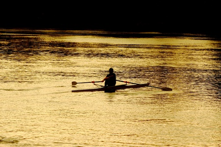 tevere: silohuette of a man rowing on a Tiber in Rome, Italy