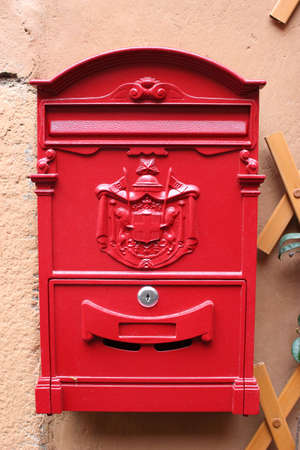 Red reproduction of wall mailbox of italian Regie Poste (Royal mail) photo