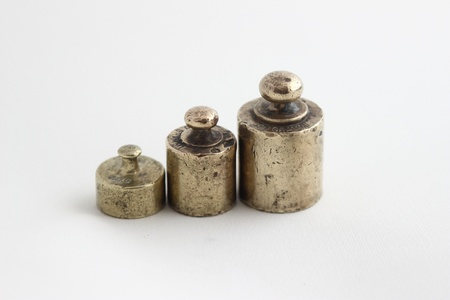 Old brass scale weight Stock fotó