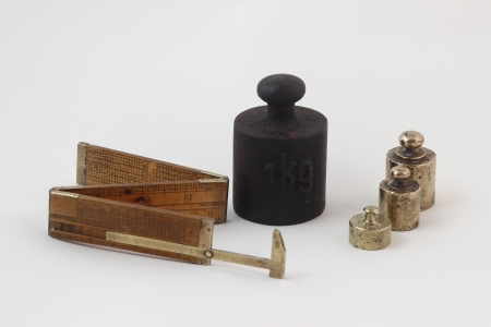 caliber: Old brass scale weight and caliber