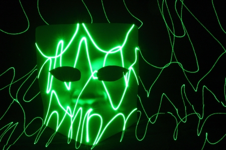 mistery: mistery mask green with light sign Stock Photo