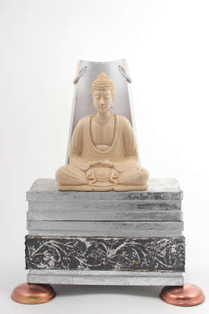 budda: Statue of budda on a silver base