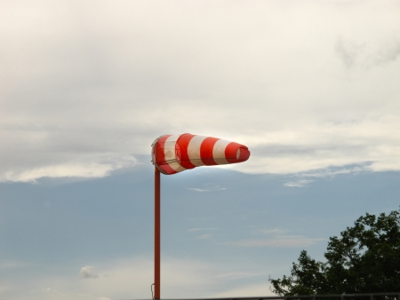 Inflated windsock and cloudy sky photo