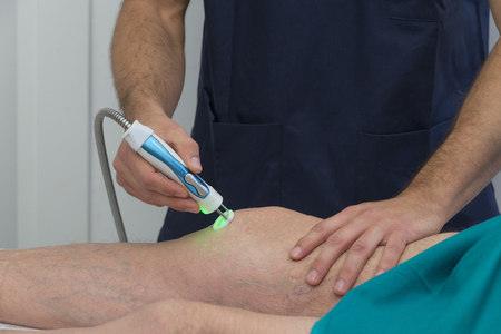Laser therapy on a knee photo