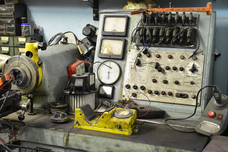 Old electro-mechanic tool in a workshop photo