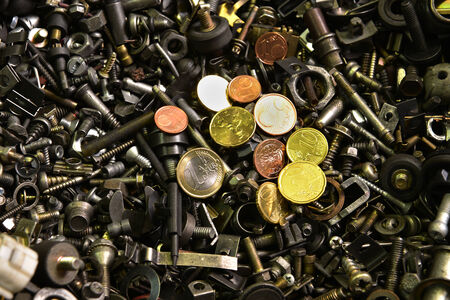 euro screw: Shine of coin in a sea of old screws