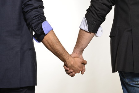 Gay couple hand by hand photo