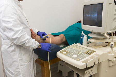 Foot echography by a medical doctor photo