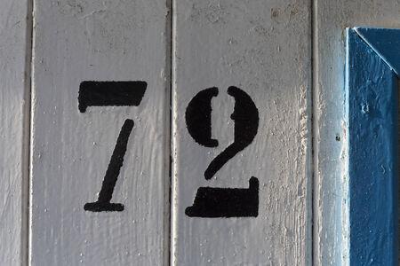seventy two: doornumber seventy two 72 Stock Photo