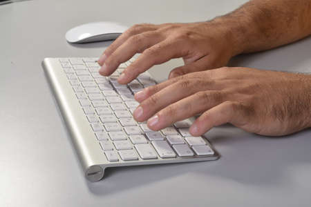 Typing fingers photo