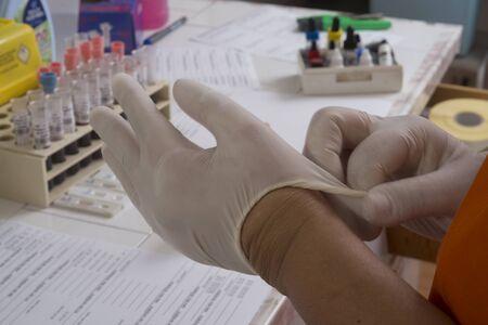 Laboratory: gloved hands