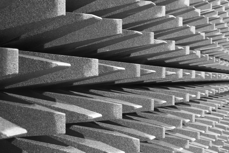 Anechoic wall for electromagnetic or sound chamber