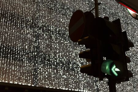 trafficlight: traffic light and christmas decoration on background