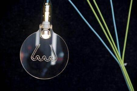 tungsten: Symbol of tungsten lamp in glass