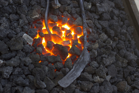 forger: Forge with coal Stock Photo