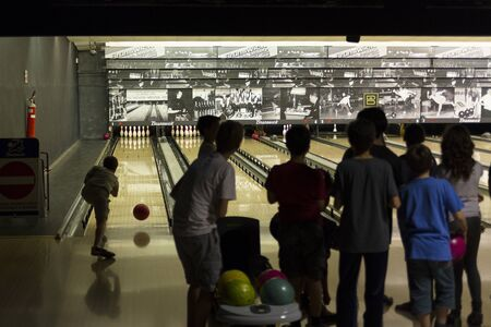 11 years: Rome, Italy, 05122015 - Childrens bowling match in Brunswick bowling center. Special children lanes were used for this match among children of secondary school, 11 years old Editorial