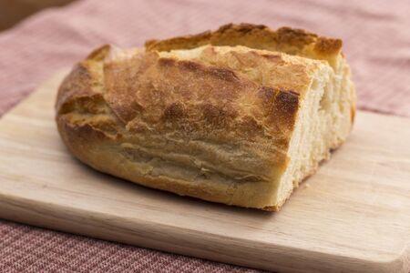 chopping board: Bread on a chopping board Stock Photo