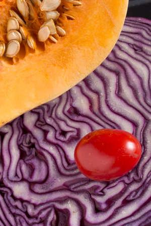 red cabbage: Pumpkin over a red cabbage Stock Photo