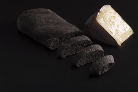 vegetable carbon: Black bread with vegetal carbon and cheese Stock Photo