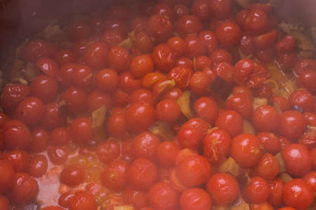 boiling: Boiling pachino variety tomatoes with eggplants Stock Photo