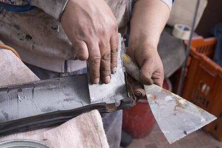 grounding: Hands grounding metal