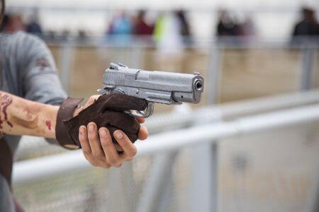 gunfire: Woman pointing a 9mm pistol Stock Photo