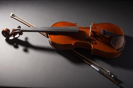stradivarius: Violin on black background