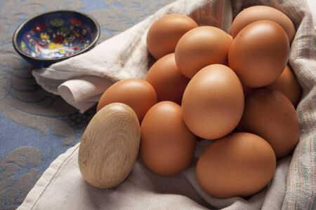 darn: Composition of many eggs in the kitchen with darning egg