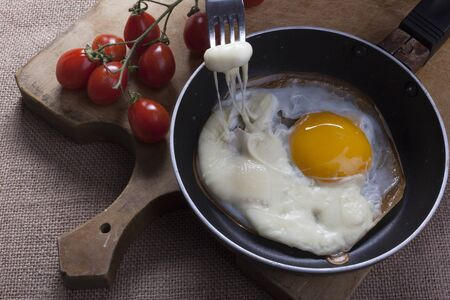 Fried eggs with cheese sliced