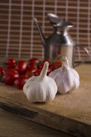 Garlic and tomatoes, basic ingredients for a tasty sauce