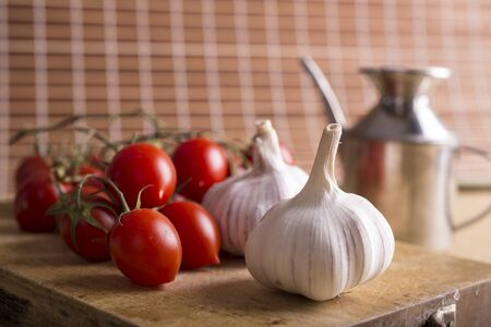 Garlic, olive oil and tomatoes, basic ingredients for a tasty sauce