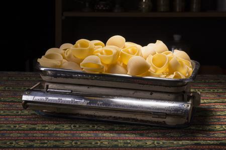 Lumaconi italian pasta in an un-equal arm balance