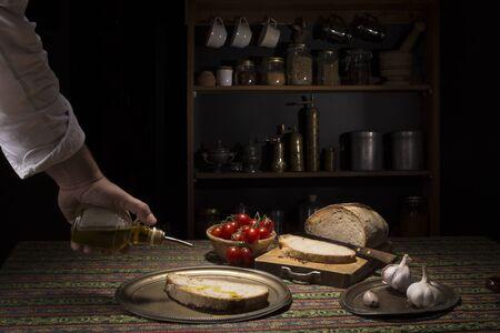 Hand pouring oil on bruschetta Stock fotó