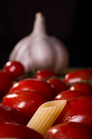 Pasta, garlic and tomatoes, basic ingredients for a tasty lunch Stock fotó