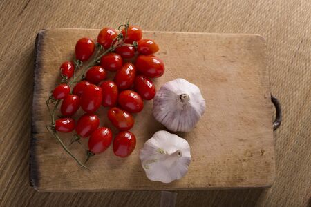 Garlic and tomatoes with windows reflection