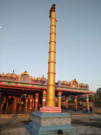 Beautiful flag pole infront of a temple